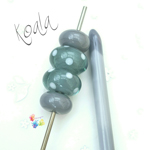 Larger beads are a base of Koala, encased in Effetre steel grey and decorated with Peace polka dots. Smaller ones are plain Koala.